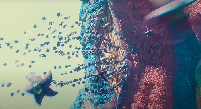 Starro releases a swarm, from Suicide Squad.